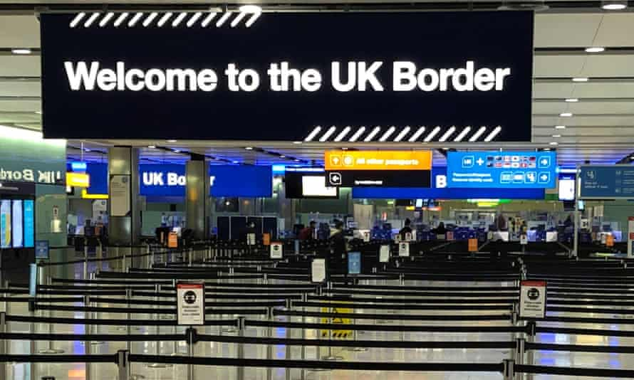 A UK border sign welcomes passengers on arrival at Heathrow.