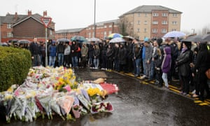 People gather at the impromptu memorial for Asad Shah on Saturday.