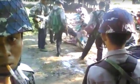 Myanmar to investigate video of police beating Rohingya villagers