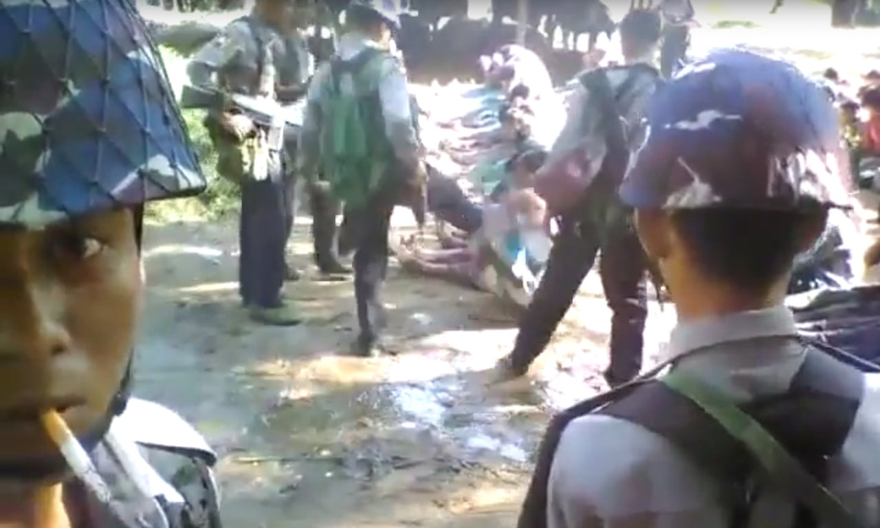 Rohingya police beating footage: Myanmar government to investigate – video