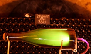 Champagne bottles in the Moët & Chandon cellars. Sales of premium French champagne fell by 28%.