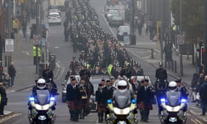 The cortege passes through Liverpool on the way to the  funeral service