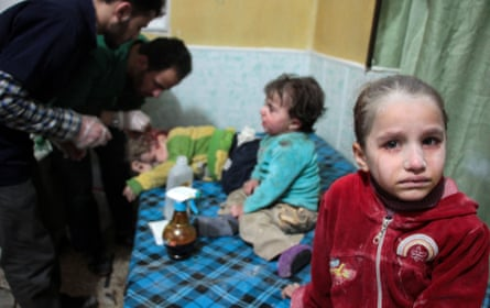 Children injured in reported shelling by Syrian government forces are seen in a makeshift clinic in Syria's eastern Ghouta region.