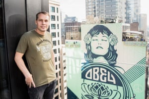 Shepard Fairey with his mural on George Street.