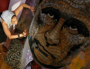 Kiev, Ukraine Dariya Marchenko works on a portrait of Russian President Vladimir Putin, named The Face of War, which is made out of 5,000 cartridges brought from the frontline in eastern Ukraine