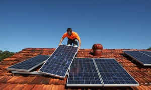 Solar system installer Bywater adjusts new solar panels on the roof of a house in Sydney<br>Solar system installer Thomas Bywater adjusts new solar panels on the roof of a house in Sydney August 19, 2009. REUTERS/Tim Wimborne (AUSTRALIA ENVIRONMENT ENERGY) - RTR26V9U ozstock