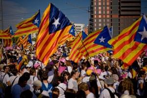 People wave Estelada flags (representing Catalan independence) in Meridiana Avenue.