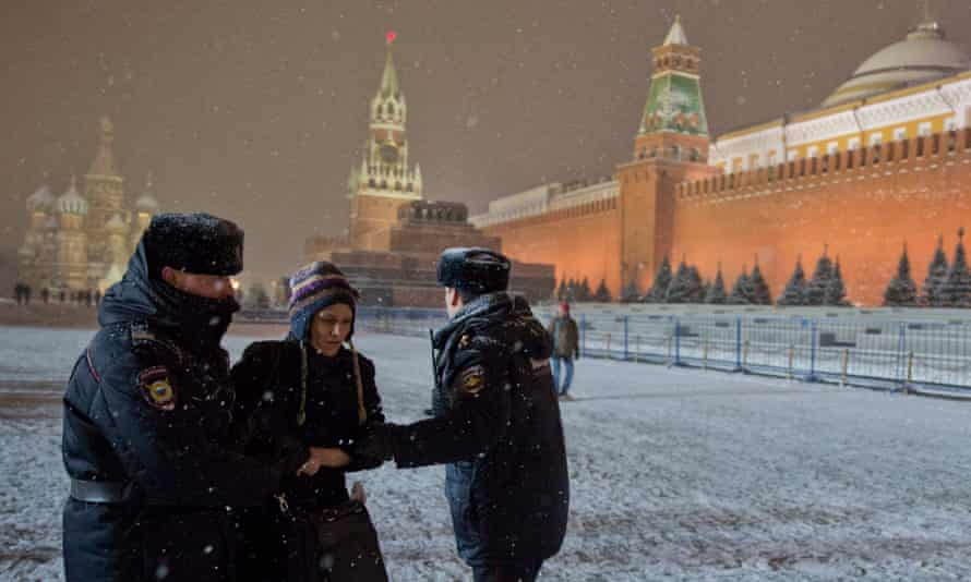 A gay rights activist is detained for attempting to hold a protest rally in Red Square, Moscow.