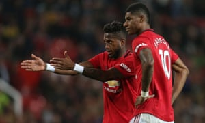 Fred and Marcus Rashford of Manchester United discuss a free kick.