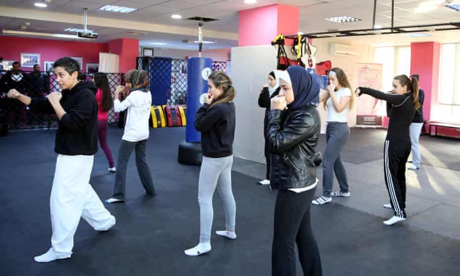 Lina Khalifa (far left) teaches a self-defence class in the Jordanian capital, Amman.