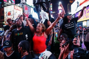 Protesters shout slogans during a protest in Times Square