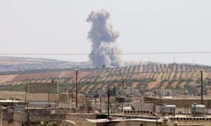 Smoke rises after warplanes belonging to the Assad regime and Russia carried out airstrikes on Idlib on Saturday.