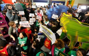 People attend a demonstration inside the venue for the climate talks in Bourget