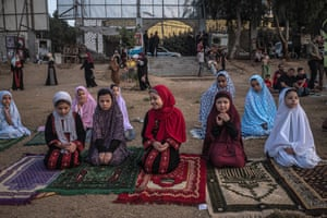 Palestinian Muslim girls perform Eid al-Adha morning prayer at Al-Saraya Square in Gaza City, Gaza