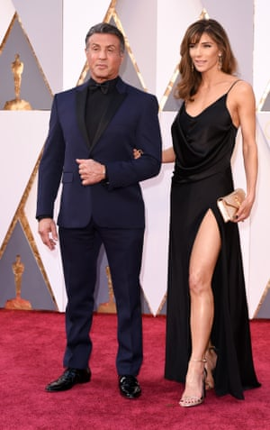 Sylvester Stallone goes for a flattering black and blue tux while and Jennifer Flavin shows what a combination of gym hours, Saint Laurent and the Left Leg legacy looks like