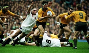 England's Paul Ackford dives full length at Australia's opposing lock, John Eales, during the 1991 Rugby World Cup final.