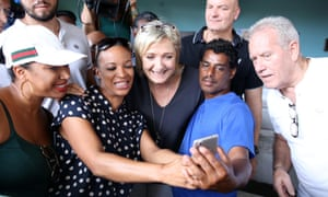 The National Front leader, Marine Le Pen, centre, poses for a selfe during a campaign visit to the Indian Ocean island of La Reunion.