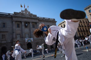 Barcelona, Spain Dozens of people practice martial arts in front of the regional government headquarters as a protest against the closure of gyms and martial arts centres in the region