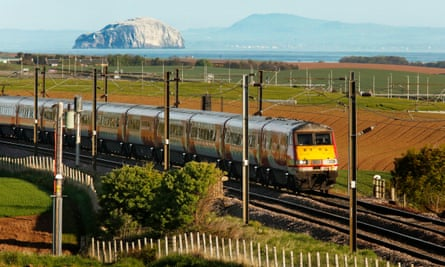 The East Coast rail service, seen here near Dunbar with the Bass Rock and Fife in the distance