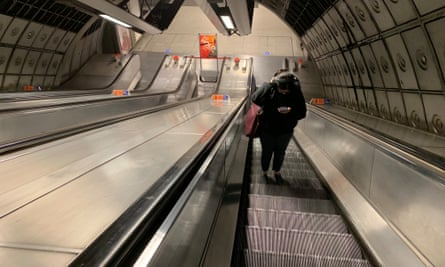 Lone passenger on the escalator at Waterloo during rush hour today