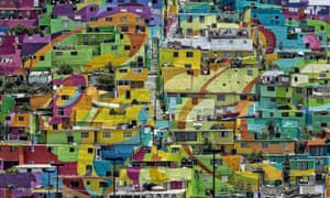Rainbow nations … Las Palmitas in Mexico, a giant example of a town painting itself.