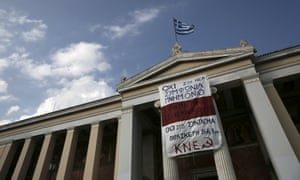 "A protest of the Greek Communist Party hangs on the facade of the University of Athens, Greece June 25, 2015. EU leaders discussed Greece's debt crisis with Prime Minister Alexis Tsipras for some two hours on Thursday in an unscheduled addition to their regular summit but insisted that negotiations be run by finance ministers, an EU official said. The banner reads: ""No to the new bailout deal, rupture with the European Union and the capital."" REUTERS/Alkis Konstantinidis"