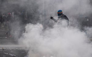 Santiago, Chile: Demonstrators clash with riot police during a tribute in commemoration of the 48th anniversary of the coup