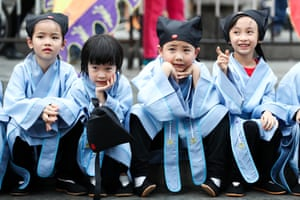 Young children in traditional clothes in Guangzhou, China