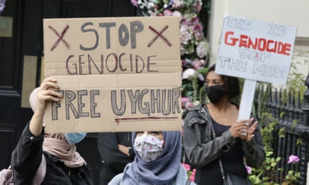 Protesters with a sign saying 'Stop genocide: free Uyghur' outside the Chinese embassy in London