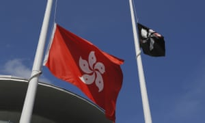 Protesters replaced the Chinese flag that is traditionally flown next to the Hong Kong flag with a black Hong Kong flag.