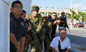 Police during the shootout with gunmen in Cancun, eastern Mexico.