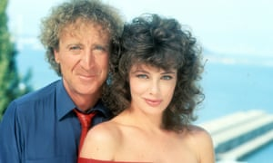 Gene Wilder and Kelly Le Brock in a publicity portrait for The Woman in Red, 1984.