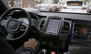 A man driving a Volvo