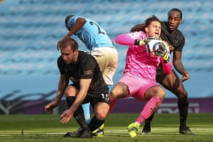 City keeper Ederson claims the ball under pressure from the Hammers' Craig Dawson and Michail Antonio.