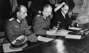 Gen Alfred Jodl, centre, signing the unconditional surrender of all armed German forces in Reims on 7 May 1945.