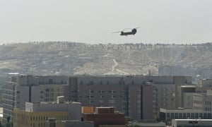 A US military helicopter is pictured flying above the US embassy in Kabul.