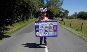 Cycling fan Florence Roville had better get out of the the middle of the road before the peloton come speeding past.