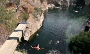 Cliff divers at Vouliagmeni lake