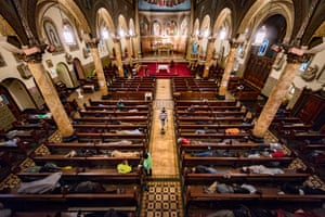 Homeless people sleep in the pews at St Boniface Catholic church in San Francisco's Tenderloin area