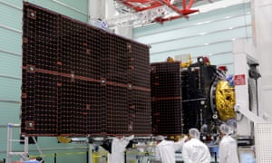 Technicians look at a solar panel on the Inmarsat S-Band/Hellas-Sat 3 satellite in the clean room facilities of the Thales Alenia Space plant in Cannes, France