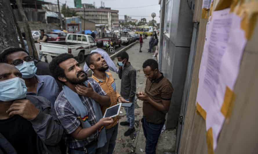 Ethiopians look at electoral results posted on the wall outside a polling station in Addis Ababa.