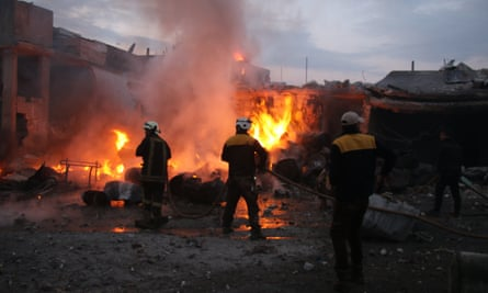 Firefightings in the rubble of a village in Idlib, Syria