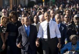 Barack Obama walks alongside Amelia Boynton Robinson, the Rev Al Sharpton, Michelle Obama, and Georgia representative John Lewis, across the Edmund Pettus Bridge to mark the 50th anniversary of the Selma to Montgomery civil rights marches in Selma, Alabama, on 7 March 2015.