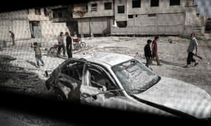 The scene outside a destroyed hospital building in Ghouta: children are trapped there without care near the Syrian capital of Damascus.