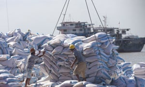 Workers in Nantong, in China's eastern Jiangsu province, unload soya beans from Brazil