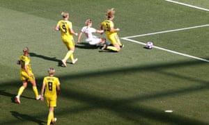 England's Ellen White slots the ball home.