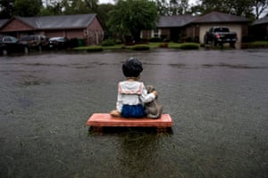 A solitary lawn ornament is seen on a flooded street in the wake of tropical storm Harvey