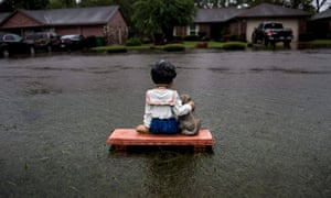 A lawn ornament is seen on a flooded street during the aftermath of Hurricane Harvey in Houston, Texas