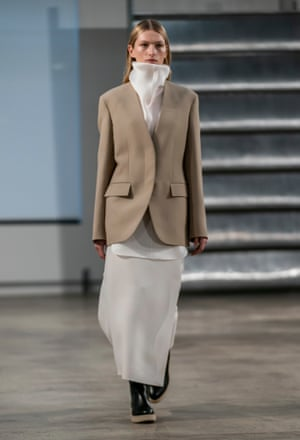 Trousers suits were worn with high-necked white shirts underneath