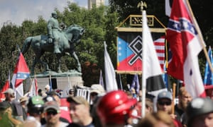 The statue of the Confederate general Robert E Lee stands behind a crowd of hundreds of white nationalists, neo-Nazis and members of the 'alt-right' during the 'Unite the Right' rally in Charlottesville, Virginia